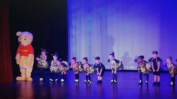 Beginner dancers on stage