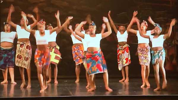 Dancers performing to African music