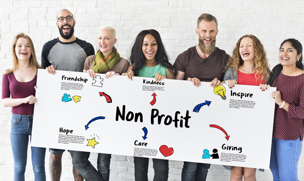 Smiling People with Non Profit Sign