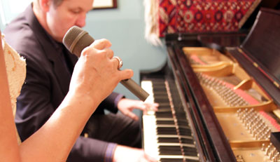 Pianist & singer's hand with microphone