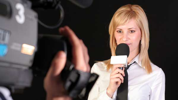 Woman with microphone being filmed